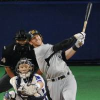 Milestone hit: Hanshin's Matt Murton smacks a seventh-inning home run for his 200th hit of the season on Thursday, becoming the fourth player in NPB history to accomplish the feat.   KYODO PHOTO