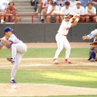 Unusual form: The National League's Hideo Nomo winds up to throw a pitch to the American League's Carlos Baerga in the 1995 MLB All-Star Game in Arlington, Texas. | KYODO PHOTO