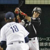 Timely hit: Chiba Lotte's Tsuyoshi Nishioka clubs a game-tying solo home run in the eighth inning of Saturday's playoff opener against Seibu. | KYODO PHOTO