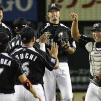 Comeback kid: Tomoya Satozaki (far right) has made a timely return for the Chiba Lotte Marines. | KYODO PHOTO