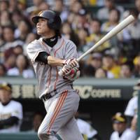 One for the road: Hayato Sakamoto hits a solo home run in the third inning against the Tigers on Saturday. | KYODO PHOTO