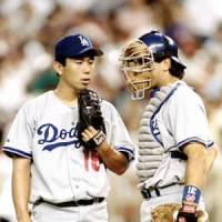 Admired: Hideo Nomo earned the respect of All-Stars like teammate Mike Piazza, as well as coaches and managers, for his ability and dedication to the game. | KYODO/REUTERS