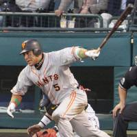 Familiar sight: Giants star Alex Ramirez strokes a two-run single in the eighth inning against the Tigers on Sunday at Koshien Stadium. Yomiuri defeated Hanshin 7-6, earning a two-game sweep in the Central League Climax Series first stage. | KYODO PHOTO