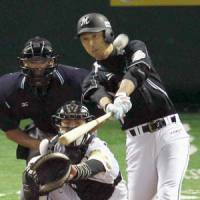 Swinging for the fences: Chiba Lotte's Makoto Imaoka smacks a solo home run in the second inning of Sunday's game at Yahoo Dome. | KYODO PHOTO