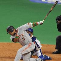 Swing and a miss: Giants slugger Alex Ramirez strikes out against Dragons reliever Akifumi Takahashi to end the eighth inning in Thursday's game. | KYODO PHOTO