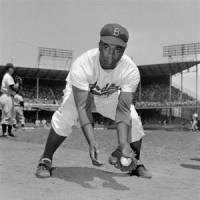 Blazing the trail: Brooklyn Dodgers second baseman Jackie Robinson, seen in a 1952 portrait, broke Major League Baseball's color barrier in 1947. | AP PHOTO