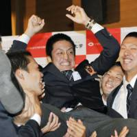 The next step: Chuo University pitcher Hirokazu Sawamura is given a doage by his teammates after being selected by the Yomiuri Giants during the NPB Draft on Thursday. | KYODO PHOTO