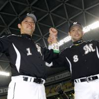 Savoring the moment: Chiba Lotte's Toshiaki Imae (right), who went 3-for-3 in Game 1 of the Japan Series, and teammate Ikuhiro Kiyota enjoy the spotlight after beating Chunichi 5-2 on Saturday. | KYODO PHOTO