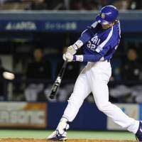Game-winning hit: The Dragons' Yohei Oshima strokes a tiebreaking triple in the 11th inning in Game 4 of the Japan Series on Wednesday at Chiba Marine Stadium. Chunichi defeated Chiba Lotte 4-3. | KYODO PHOTO