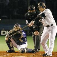 Key hit: Chiba Lotte's Tadahito Iguchi slugs a two-run homer to right field in the third inning. | KYODO PHOTO