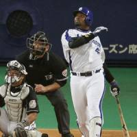 Watch it fly: Dragons slugger Tony Blanco clubs an opposite-field run-scoring double in the sixth inning in Game 6 of the Japan Series on Saturday. | KYODO PHOTO