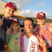 Beach Pit BBQ operator Tim DeCinces with daughters Delaney, Riley and Paige, wearing the Rakuten Eagles logo. DeCinces contributed 50 percent of sales at six California locations on March 28 to benefit victims of the March 11 earthquake-tsunami in Japan's Tohoku district.