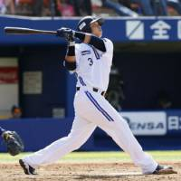 Sledge Hammer: BayStars slugger Terrmel Sledge hits one of his three homers against the Dragons on Wednesday in Yokohama. It wasn't enough as Chunichi rallied to win 8-7. | KYODO