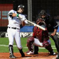 Big blast: Chiba Lotte's Kazuya Fukuura smacks a two-run home run in the sixth inning against Tohoku Rakuten on Thursday at QVC Marine Field. The Marines beat the Eagles 5-2. | KYODO PHOTO