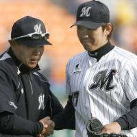 What a game: Yoshihisa Naruse, right, is congratulated by Marines manager Norifumi Nishimura after striking out 12 in a six-hit shutout in a 6-0 win against Orix on Tuesday. | KYODO