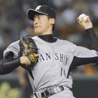 Eye of the Tiger: Hanshin southpaw Atsushi Nomi fires a pitch to a Yomiuri batter during Tuesday's game at Tokyo Dome. The Tigers beat the Giants 7-3. | KYODO