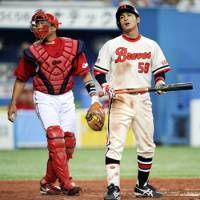 Brave face: Orix's Yusuke Kajimoto reacts after missing a sacrifice bunt attempt during the Buffaloes' 3-2 loss to the Carp on Saturday. | KYODO PHOTO