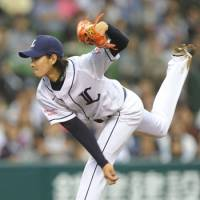 Pinpoint control: Seibu Lions hurler Takayuki Kishi fans seven batters in seven innings in a 3-2 victory over the Tokyo Yakult Swallows on Saturday at Seibu Dome.   KYODO PHOTO