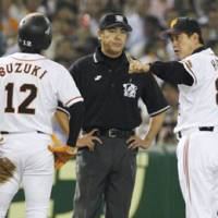 You cannot be serious: Giants manager Tatsunori Hara (right) argues a call with the third base umpire during Yomiuri's 2-0 loss to the Fighters on Monday night. | KYODO PHOTO