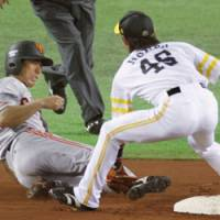 Not in time: Giants star Michihiro Ogasawara is tagged out by Hawks second baseman Yuichi Honda on Thursday at Yahoo Dome. The Hawks won 2-0. | KYODO PHOTO