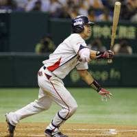 Hit man: Tokyo Yakult's Norichika Aoki gets one of his three hits in Thursday night's 4-4 tie with the Yomiuri Giants at Tokyo Dome. Earlier, the Swallows outfielder was announced as the top vote-getter for this year's All-Star games. | KYODO PHOTO