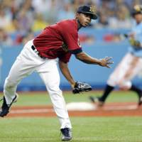 Buff stuff: Orix pitcher Alfredo Figaro throws to first during the Buffaloes' 2-1 win over the Hawks on Sunday. | KYODO