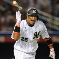 Welcome aboard: Chiba Lotte's Jose Castillo hits a game-tying single in Tuesday's 8-7 win over the Fighters. | KYODO