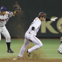 Thieves never prosper: Yomiuri's Hisayoshi Chono steals second base during the Giants' 2-1 defeat to the Swallows at Tokyo Dome on Friday night.   KYODO