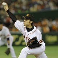 Busy day at the office: Kentaro Nishimura fires one of his 139 pitches in a complete-game effort against the Swallows on Saturday at Tokyo Dome. Yomiuri beat Tokyo Yakult 6-3. | KYODO PHOTO