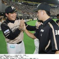 Happy moment: Hokkaido Nippon Ham Fighters skipper Masataka Nashida (left) congratulates pitcher Yuki Saito after the team's 1-0 win over the Seibu Lions on Sunday. | KYODO
