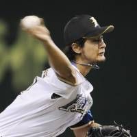 Winning formula: Fighters ace Yu Darvish throws a pitch against the Eagles on Wednesday at Tokyo Dome. The Fighters won 3-1 to help Darvish improve to 13-2 this season. | KYODO