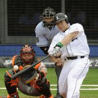Let it ride: The Lions' Takeya Nakamura smacks a fourth-inning solo homer in the Pacific League's 4-3 win over the Central League in Game 2 of the All-Star Series in Chiba on Saturday. | KYODO PHOTO