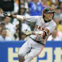 Afternoon enjoyment: Giants star Hayato Sakamoto, who went 3-for-5 in Game 2 of the All-Star Series on Saturday, is doing his part to lift fans' spirits. Swallows pitcher Yoshinori Sato cited this motivation before his scheduled start on Sunday. | KYODO PHOTO