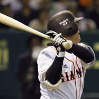 All square: Giants outfielder Yoshinobu Takahashi hits a game-tying solo homer against the Tigers on Wednesday at Tokyo Dome. Yomiuri won 3-2. | KYODO