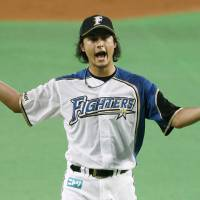 Like a magician: Fighters hurler Yu Darvish fans 14 batters in a 4-0 win over the Hawks at Sapporo Dome on Friday. | KYODO PHOTO