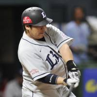 Uncaged: Lions slugger Takeya Nakamura hits a run-scoring single in the seventh inning against the Hawks on Wednesday in Fukuoka. He added a solo homer in the ninth in Seibu's 2-1 win. | KYODO PHOTO