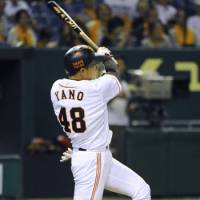 Kenji Yano of the Giants belts a grand slam during the seventh inning of Friday's game against the Carp.