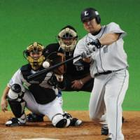 And away it goes: Lions slugger Takeya Nakamura bashes a solo home run in the fourth inning against the Fighters on Sunday. Seibu beat Hokkaido Nippon Ham 6-2. | KYODO