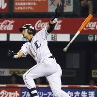 Three's a crowd: Seibu's Hideto Asamura hits a three-run home run during the Lions' 11-3 win over the Marines on Wednesday. | KYODO