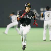 Go, go, go: Softbank's Yuichi Honda runs to third base after hitting a triple against the Fighters on Thursday. | KYODO PHOTO