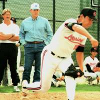 Center of attention: Hideki Irabu pitches at the Chiba Lotte Marines' training camp in February 1995 under the watchful eyes of manager Bobby Valentine (left), pitching coach Tom House (center) and MLB legend Nolan Ryan. | KYODO PHOTOS