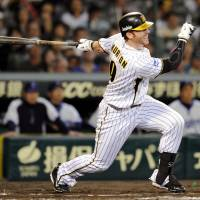 Stick maestro: Tigers star Matt Murton bashes a bases-clearing double in the sixth inning at Koshien Stadium on Friday against the BayStars. Hanshin defeated Yokohama 4-2. | KYODO