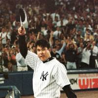 Smashing debut: Hideki Irabu takes a curtain call after his debut with the New York Yankees on July 10, 1997. Irabu pitched 6? innings and struck out nine in a 10-3 victory over the Detroit Tigers. | KYODO PHOTOS
