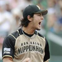 Decision looms: The first stage of the Pacific League Climax Series between the Hokkaido Nippon Ham Fighters and Seibu Lions could represent star Yu Darvish's farewell to Japanese baseball. | KYODO PHOTO