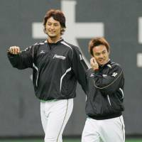 Top gun: Hokkaido Nippon Ham pitcher Yu Darvish (left) will start Game 1 of the first round of the Pacific League Climax Series against the Lions on Saturday.   KYODO