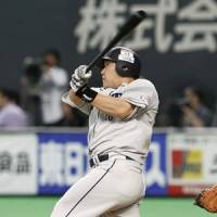 Big blast: Seibu's Takeya Nakamura belts a three-run home run in the ninth inning in Game 2 of the Pacific League Climax Series first stage Sunday at Sapporo Dome against Hokkaido Nippon Ham. The Lions won 8-1 to advance to the second stage. | KYODO