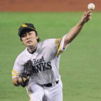 Stepping up: Hawks southpaw Tsuyoshi Wada holds the Lions to one run over seven solid innings in Game 1 of the Pacific League Climax Series final stage on Thursday at Yahoo Dome. Fukuoka Softbank beat Seibu 4-2. | KYODO PHOTO