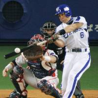 Title shot: Hirokazu Ibata hits a two-run home run during the Dragons' 2-1 win over the Swallows in the CLCS final stage on Sunday. The Dragons advanced to the Japan Series with the victory. | KYODO PHOTO