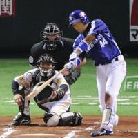Decisive play: The Dragons' Masaaki Koike hits a 10th-inning solo home run in Game 1 of the Japan Series on Saturday at Yahoo Dome. Chunichi beat Fukuoka Softbank 2-1. | KYODO