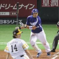 Deja vu: Dragons third baseman Masahiko Morino hits a go-ahead RBI single in the 10th inning off Hawks reliever Takahiro Mahara on Sunday during Game 2 of the Japan Series in Fukuoka. The Dragons won 2-1 to take a 2-0 series lead. | KYODO PHOTO